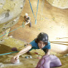 Female climber on an intro to climbing course with Southampton Climbing Wall